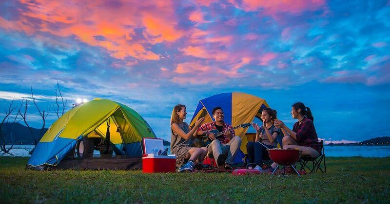 People Enjoying the Camping with a sunset