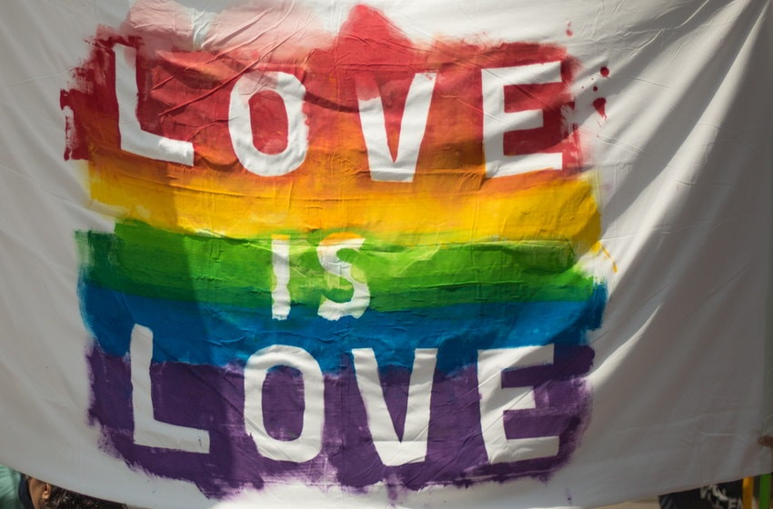 Image of a flag that says love is life referencing LGBTQIA nightlife in NJ