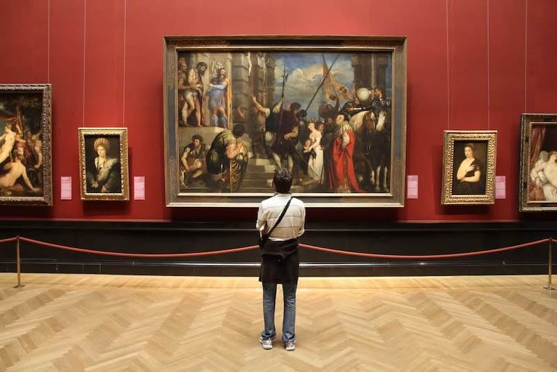 Person Standing and watching frame in museum
