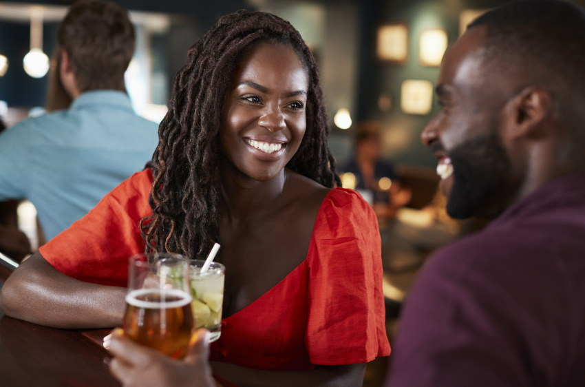 An image of a couple having a drink at the bar as an idea for things to do on a Friday night in NJ