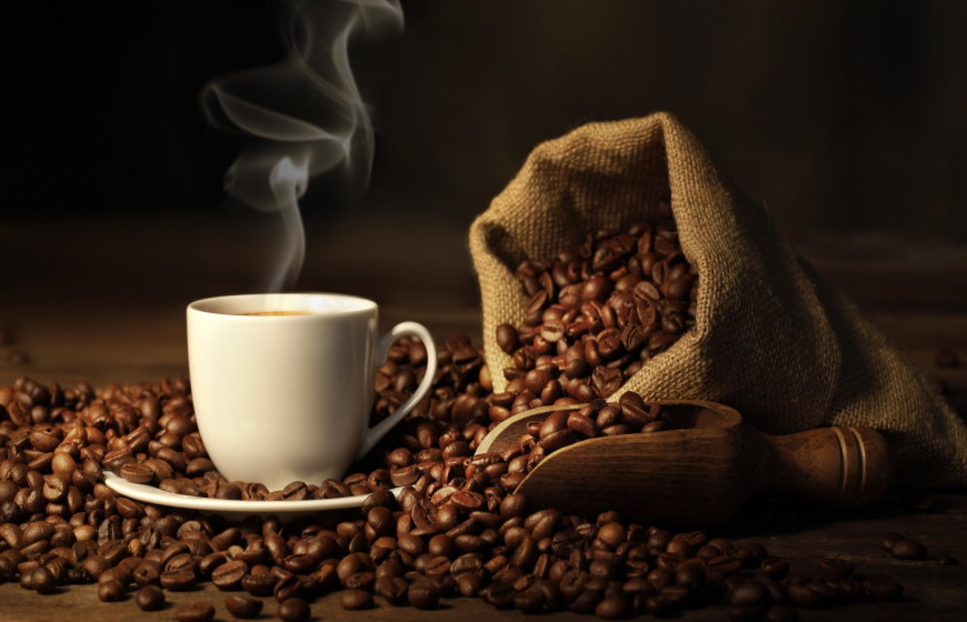 Hot coffee cup with fresh beans