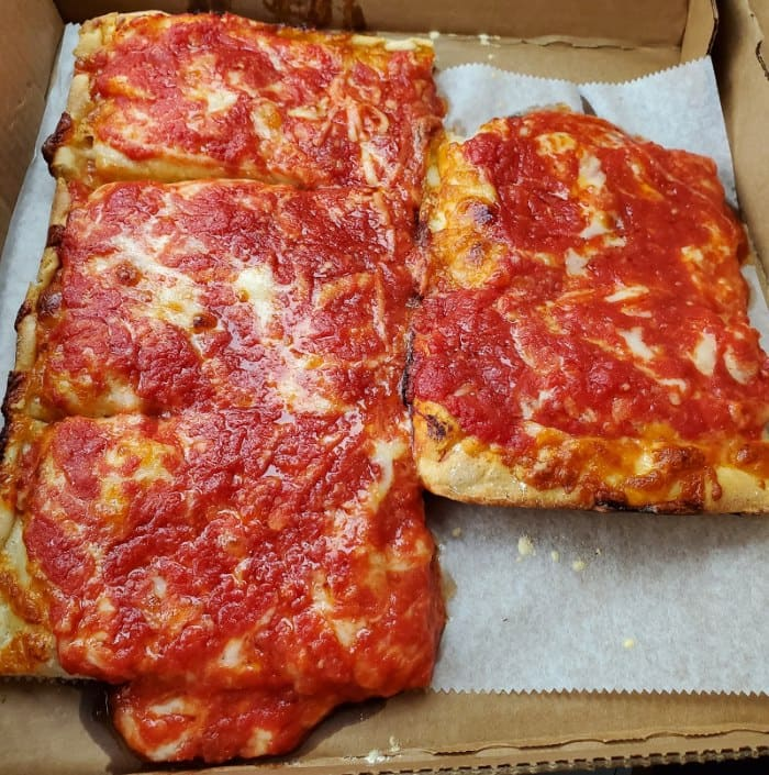 Image of 4 slices of pizza from Kate and Al's Pizza at the Columbus Flea Market in Columbus NJ