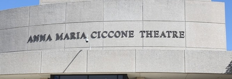 Photo of the front of The Ciccone Theater a gray building.