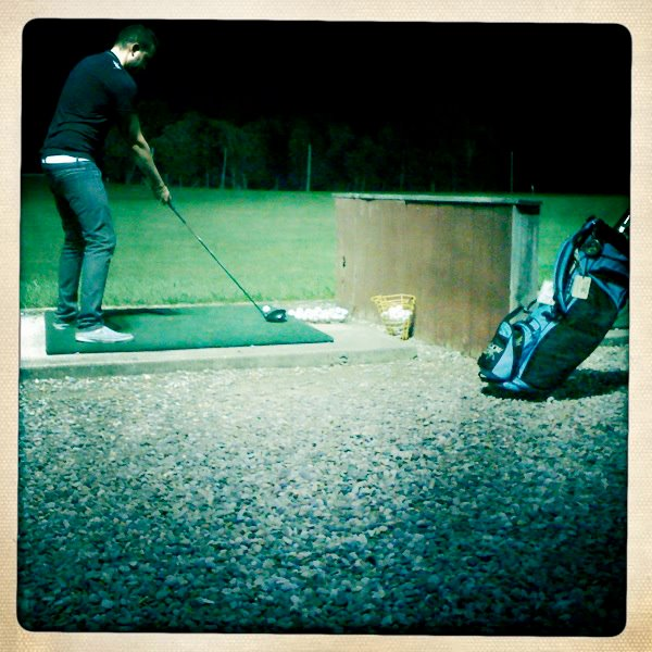 Photo of a man at a driving range at Farmer Browns Mini Golf.