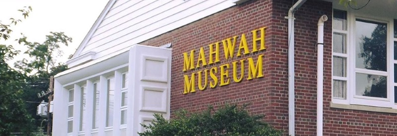 Photo of the front of The Mahwah Museum a red brick building with yellow letters.