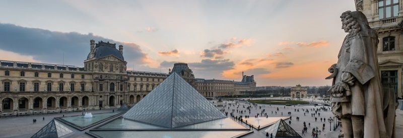 Image of the Louvre Museum in Paris France with art installments and statues.