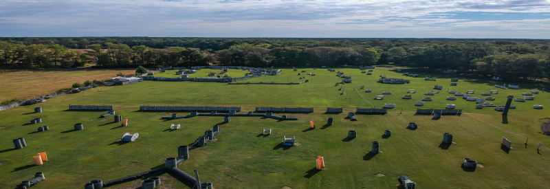 Photo of Top Gun Paintballs' massive out door paintball field with tons of places to take cover in massive scale paintball battles