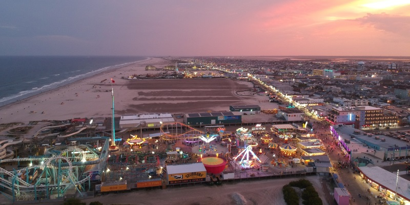 Ariel photo of Wildwood New Jersey and the famous Wildwood Boardwalk with the sun setting behind it.
