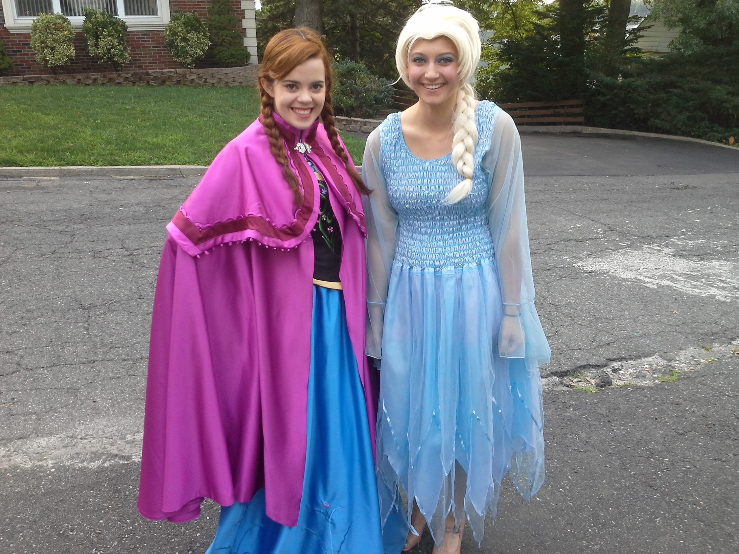 Image of two princesses smiling wearing dresses