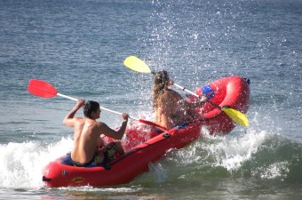Image of two people in a raft with paddles floating through the water as an adventurous date idea in NJ