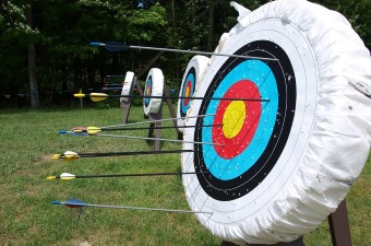 Image of arrows stuck in a target at an archery range sports center in NJ