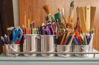 Image of art supplies including colored pencils scissors markers and paintbrushes showing at classes in NJ
