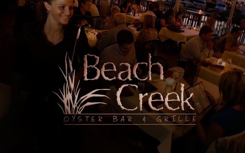 Beach Creeks Logo With Patrons Dining in the Back