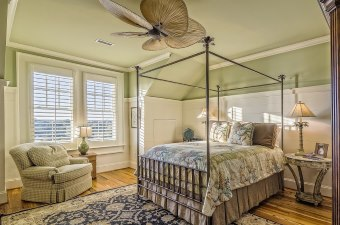 Photo of a bed in a decorated room showing bed and breakfasts as one of the best New Jersey Getaways