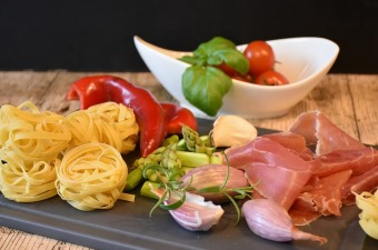 Image of pasta sliced meats tomatoes and mozzarella showing the best restaurants by cuisine in NJ