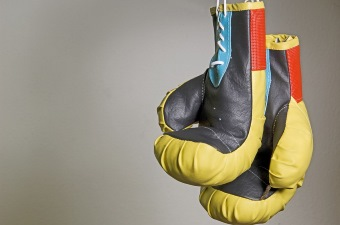 Image of black and yellow boxing gloves showing martial arts classes in NJ
