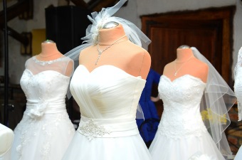 Image of three wedding dresses on mannequins at a bridal boutique as part of our NJ Wedding Guide