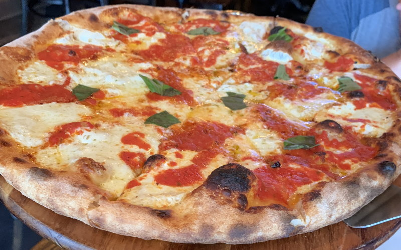 Image of a beautiful Margherita Pizza from Capri Wood Fired Pizza & Trattoria in Manalapan NJ