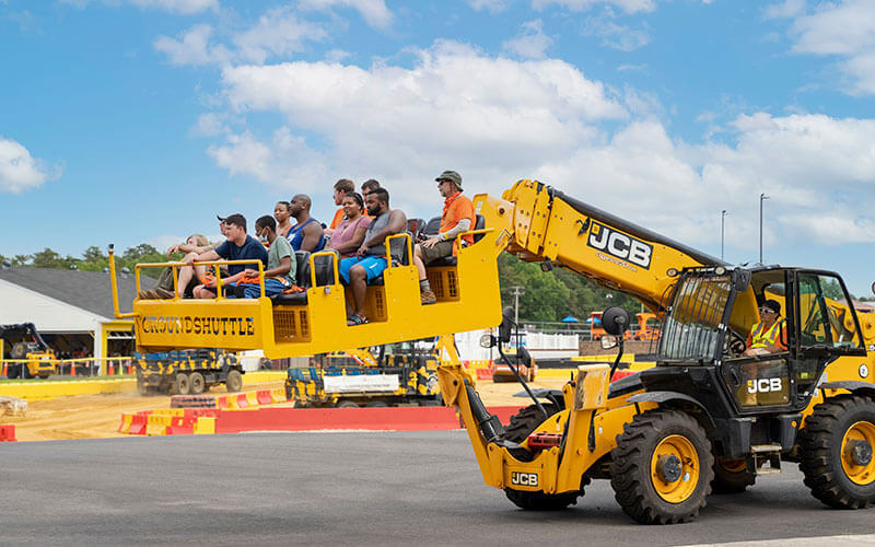 Family takes a ride on the Ground Shuttle ride at Diggerland USA in West Berlin, NJ