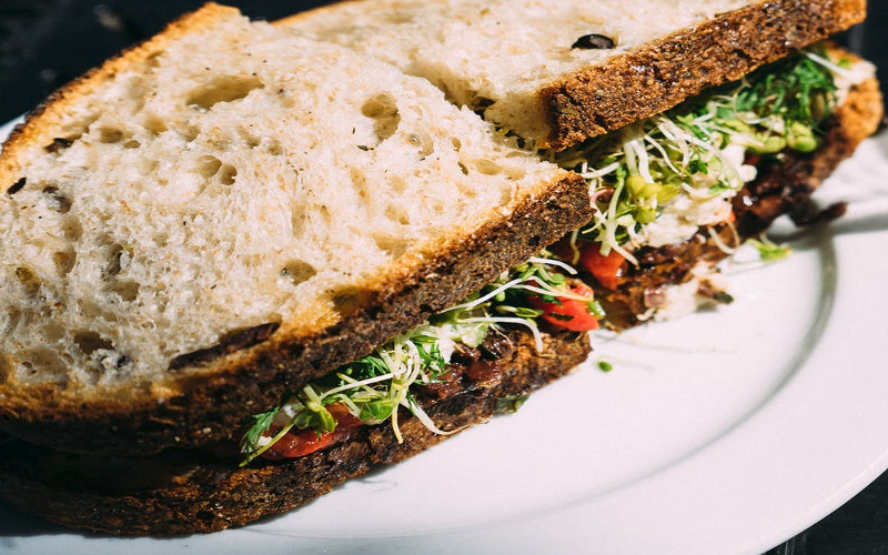 Try a delicious pistrami sandwich - to split with the whole family at Harold's Deli.
