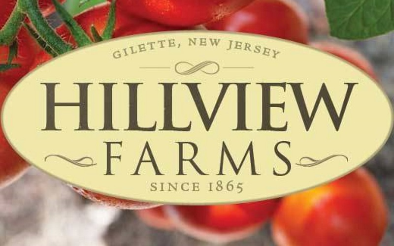 Image of Hillview Farms logo with tomatoes behind it.