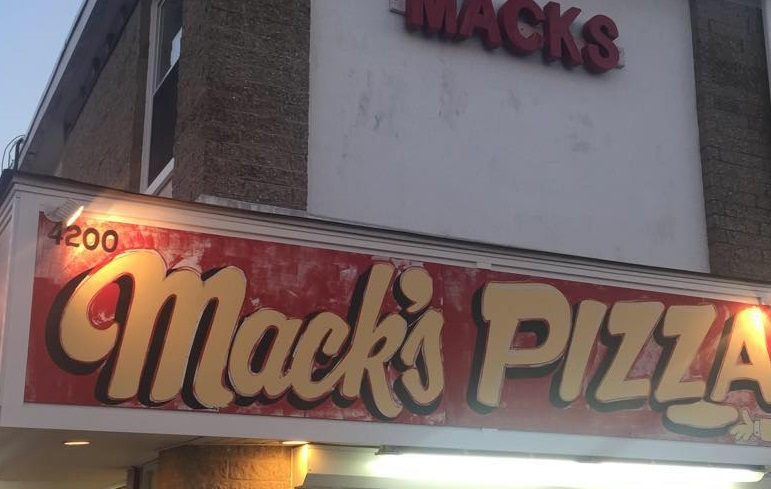 Image of the sign in front of Mack's Pizza