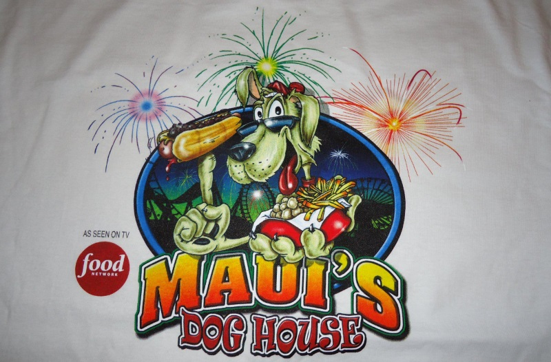 Maui's Dog Houses logo. A cartoon dog holding a hot dog.