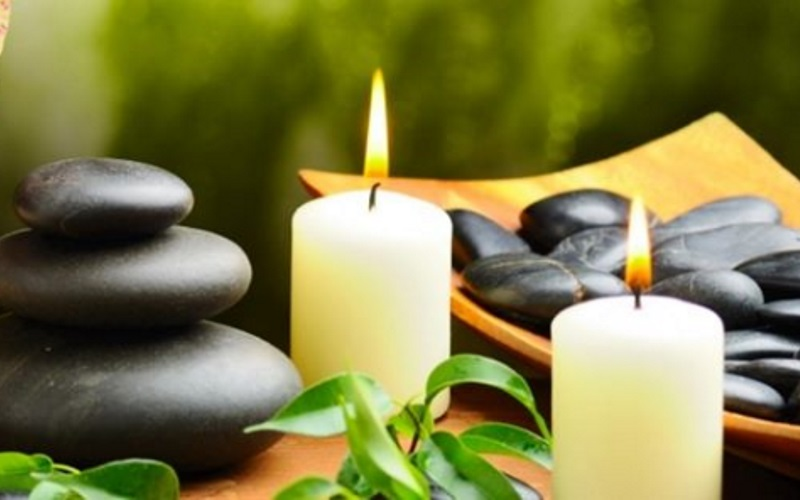 Image of candles and stacked stones