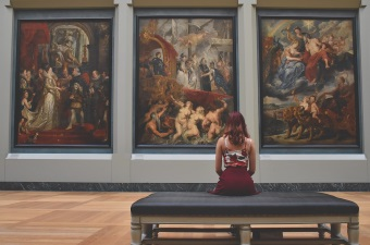 Image of a girl looking at a painting in an art gallery as part of NJ arts and culture