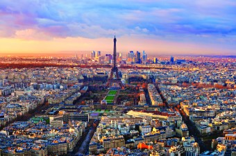 A long shot aerial image landscape of the Eiffel Tower in the middle of the city Paris France.