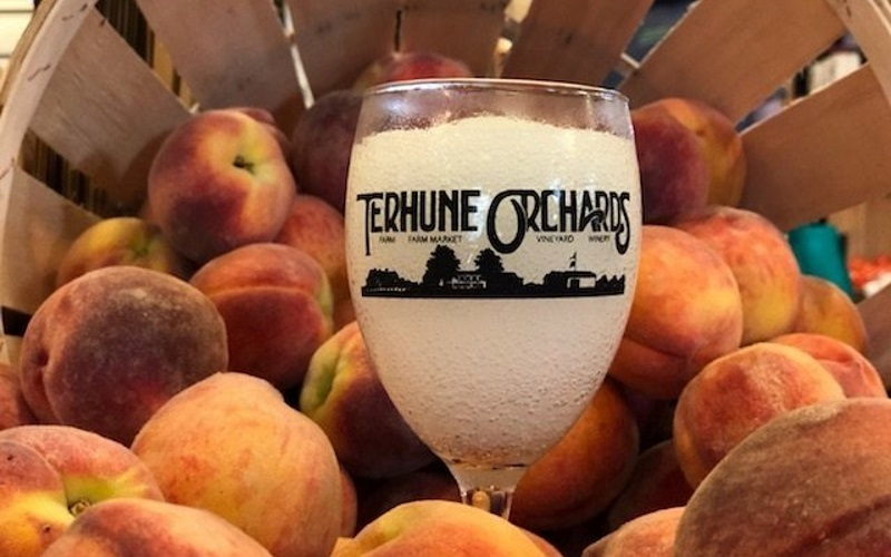 Image of a wineglass full on peaches
