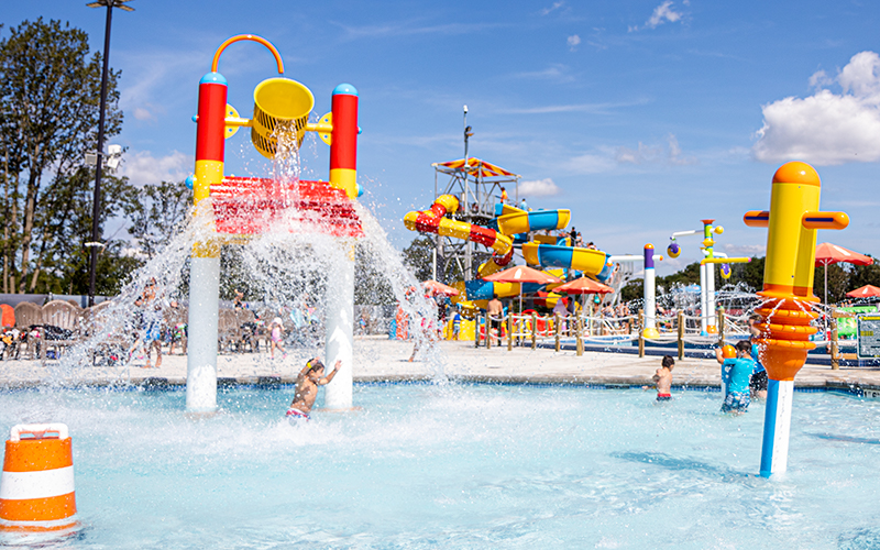 Kids having fun and getting splashed at Diggerland USA's new construction-themed water park in South Jersey.