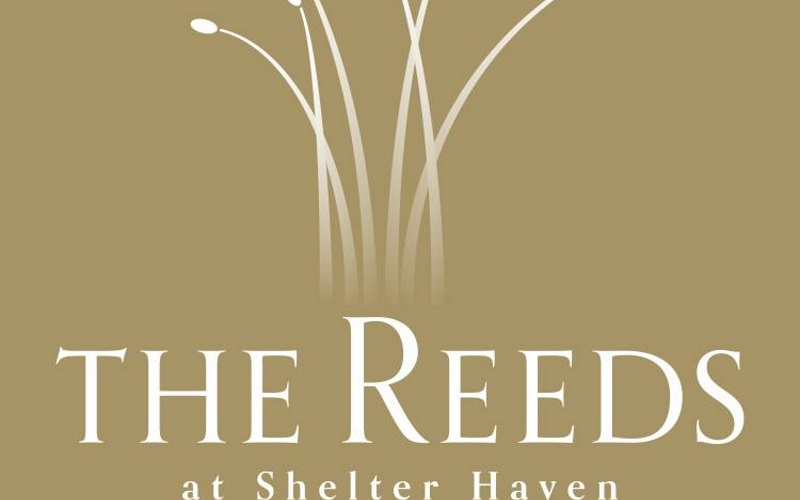 The Reeds at Shelter Haven's logo