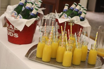 Image of glass bottles of orange juice on a tray at a special occasion in NJ