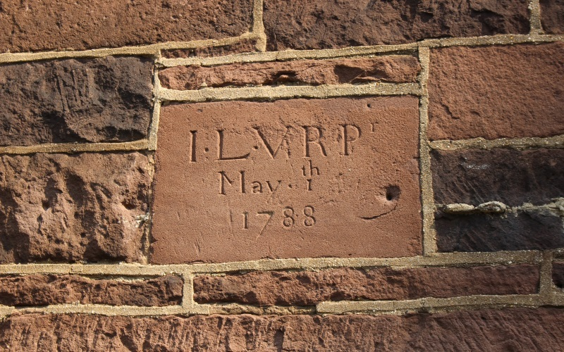 Image of the red brick cornerstone of the Van Riper house with the date 1788