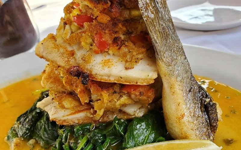 Image of a fish dish with spinach