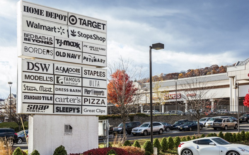 Image of the sign in front of Watchung Square Mall with various businesses listed
